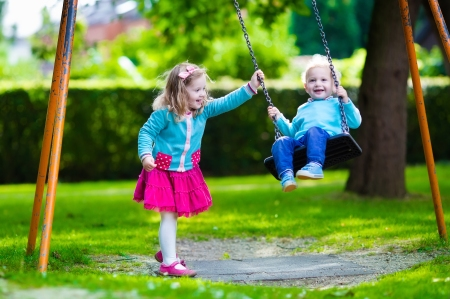 Kids On Playground Swing